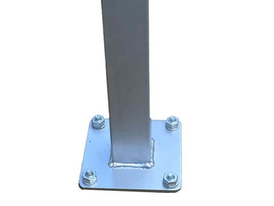 A steel base plate post, four bolts and nuts fixed on the plate.