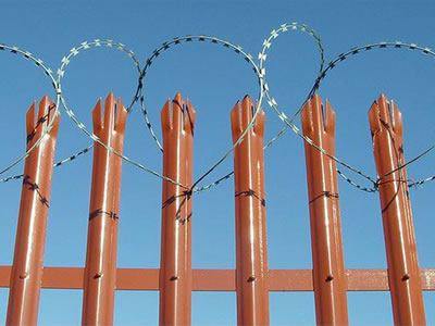 The orange PVC palisade fence with razor wire winding at the top, the fence is triple pointed head and D section pale.