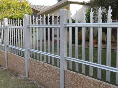 Triple & notched galvanized palisade fence on the wall, they serve as a security fence for private yard together.