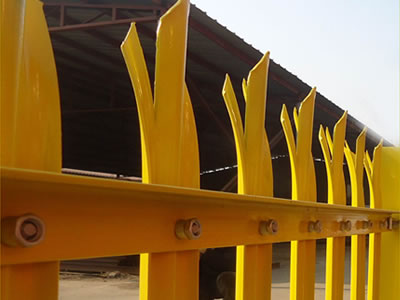 Yellow coated PVC palisade fence for factory, with W section pale and triple pointed head style.